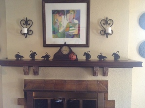 I am surprise my mother put rats on the mantle.. She usually screams when one is spotted.